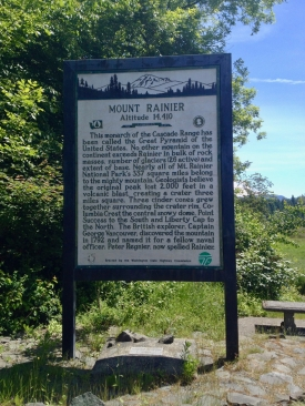 A sign containing information about Mount Rainier.