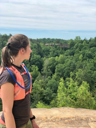 Rebekah with Natural Bridge in the distance. Photo by Curt Whitacre.